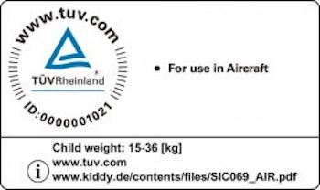 TÜV-Zeichen eines Kindersitzes mit Flugzeugzulassung
